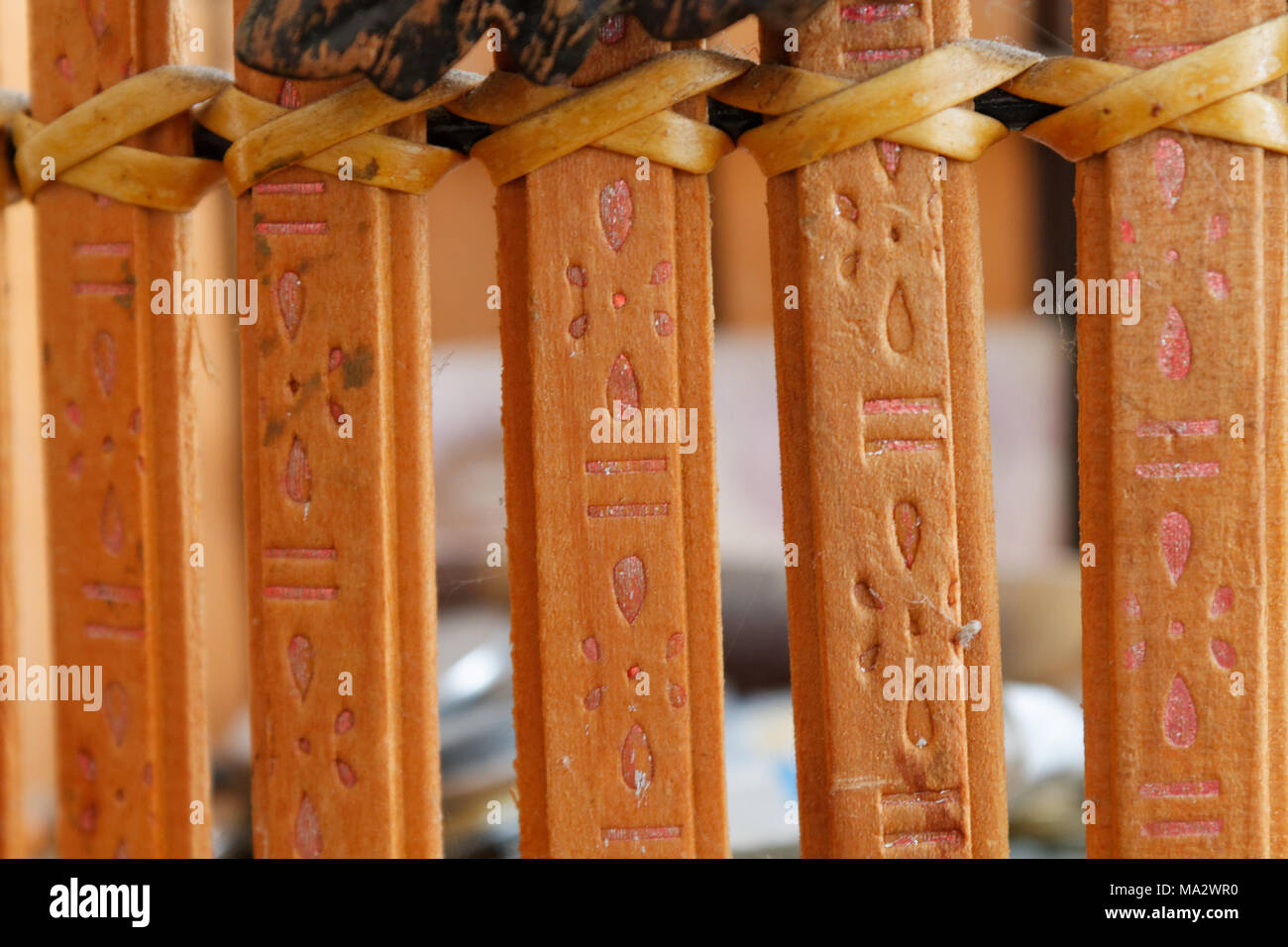 Old strong wooden planks with steel ornate, close-up background - Stock Image