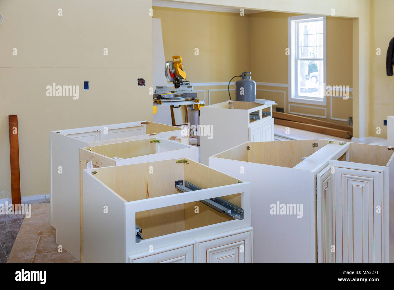 Installing New Modern Kitchen Installation Of Kitchen Cabinet Of Installation Base For Island In Center Stock Photo Alamy