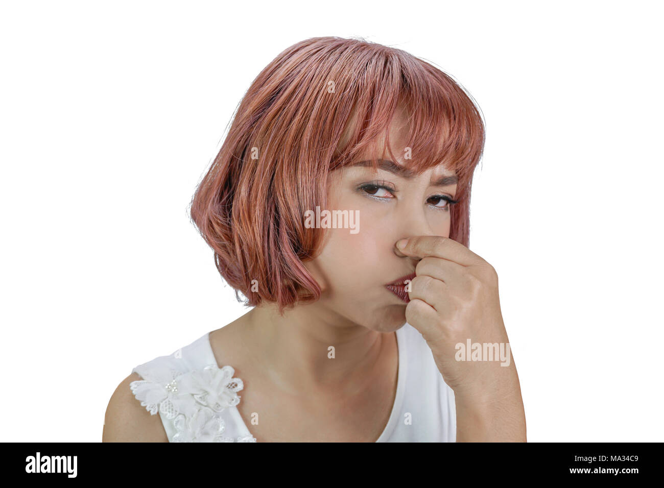 Asian woman pinches her nose for bad smell concept,  isolated on white background with clipping path - Stock Image