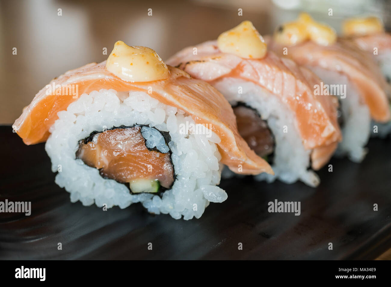 Grilled Salmon Sushi Roll Japanese Food Style On Black Ceramic Dish Stock Photo Alamy