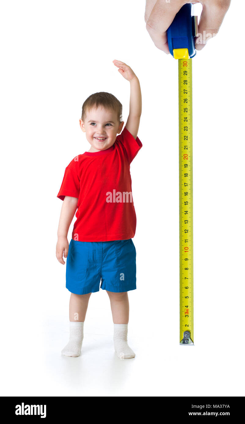 Kid growing measuring with ruler - Stock Image