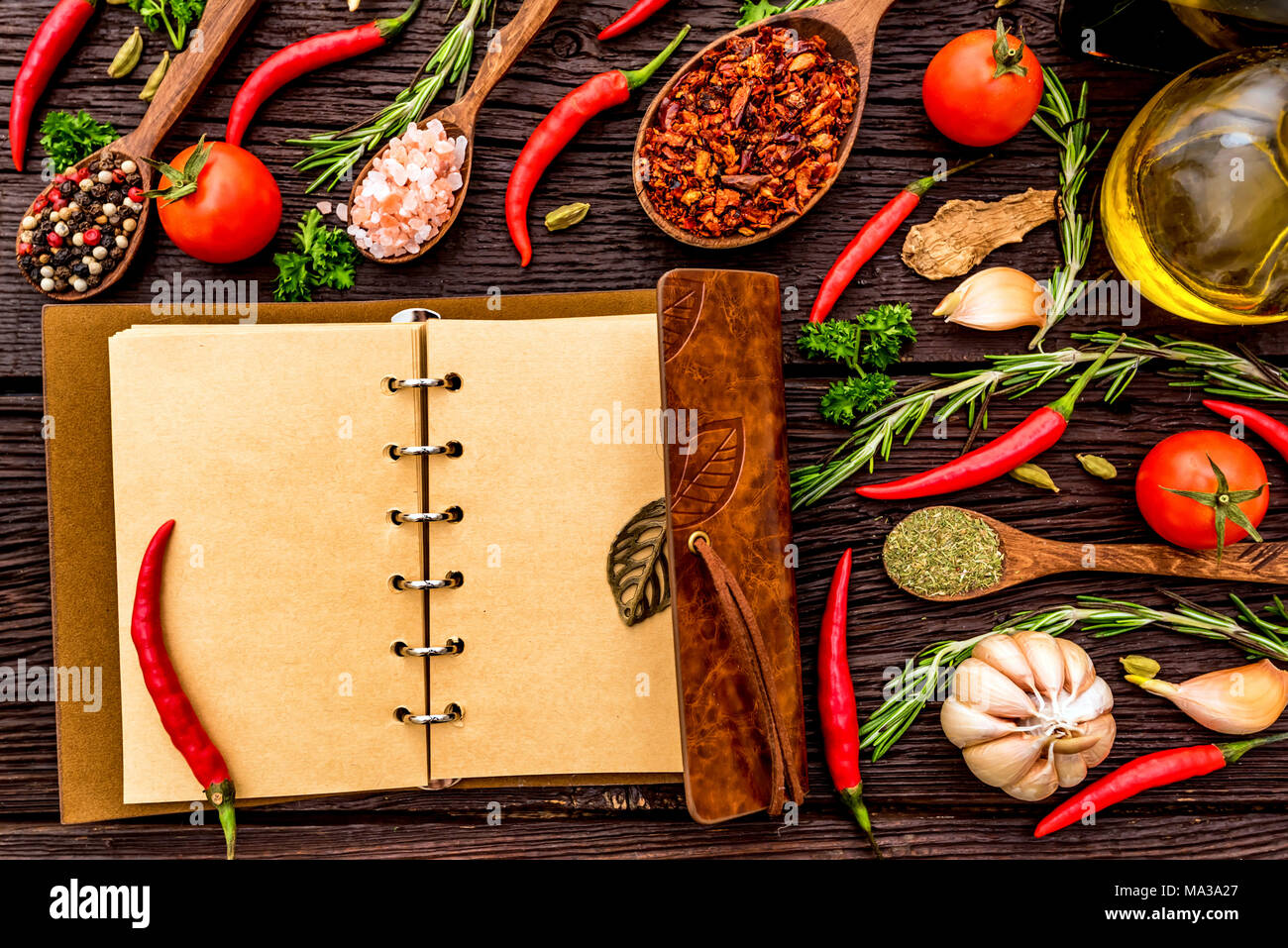 Top View Open Recipe Book With Chili Peppers Garlic Oil Balsamic Vinegar Salt Herbs And Spices On Wooden Background Cooking Concept Selective F Stock Photo Alamy