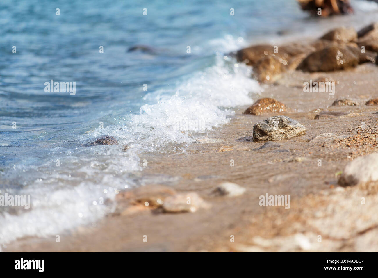 Gentle waves, beach - Stock Image