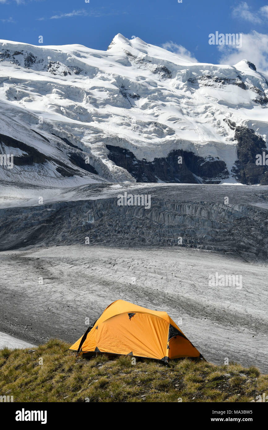 Camping on the ridge of moraine, close to the Grand Combin glacier, Grand Combin on background,Switzerland,Swiss - Stock Image