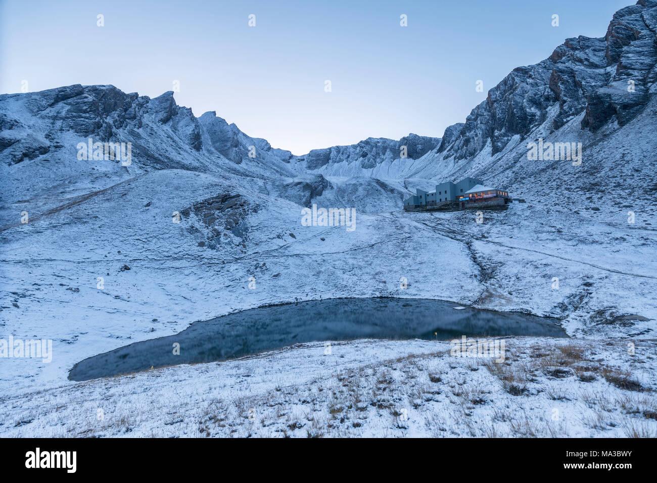 Lake below Refuge Frassati at dusk with snow, Saint Rhemy en Bosses, Gran San Bernardo valley, Aosta Valley, Italy, Europe Stock Photo