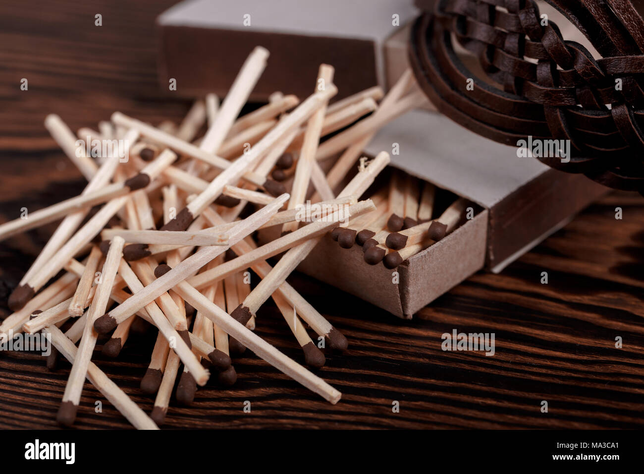 Matches in open match box on wood background - Stock Image