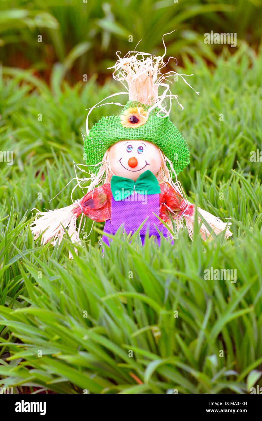Garden decoration, little man made of fabric and bast fibres - Stock Image