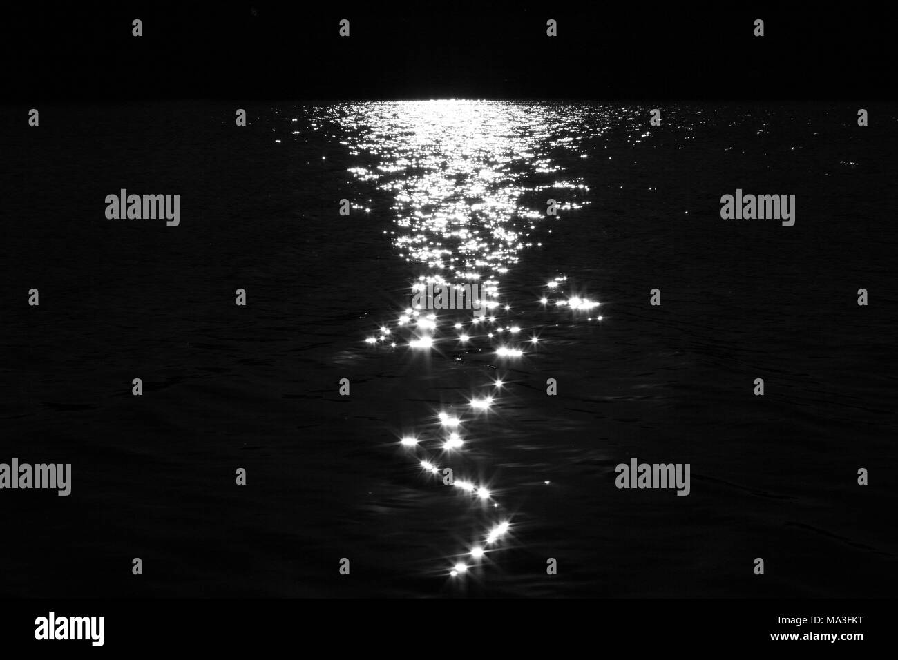 Reflection of sunlight on water - Stock Image