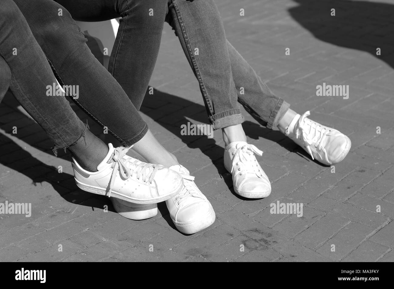Black trousers, white Sneakers - Stock Image