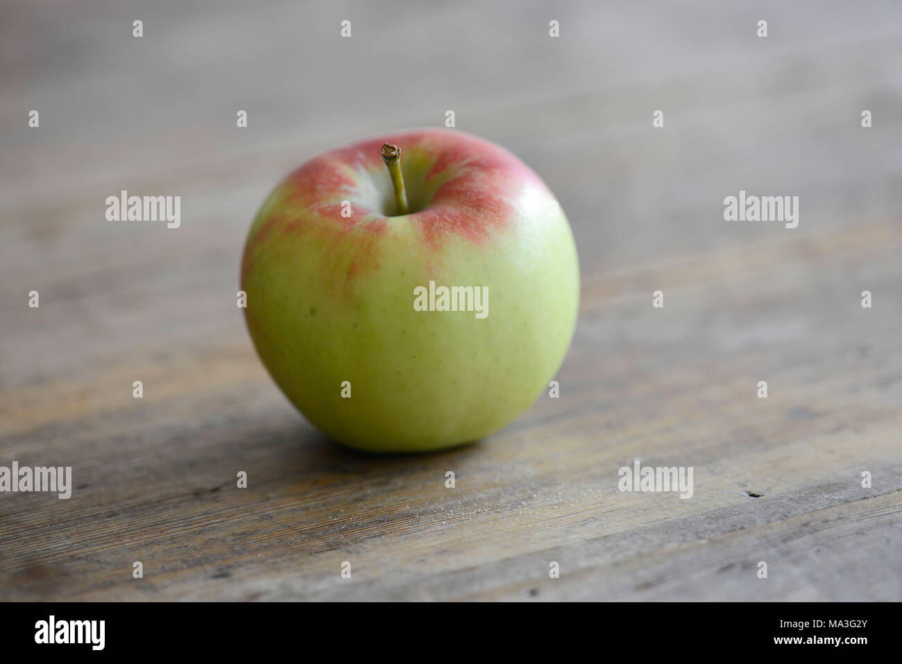 Apple, wooden table, fruit - Stock Image