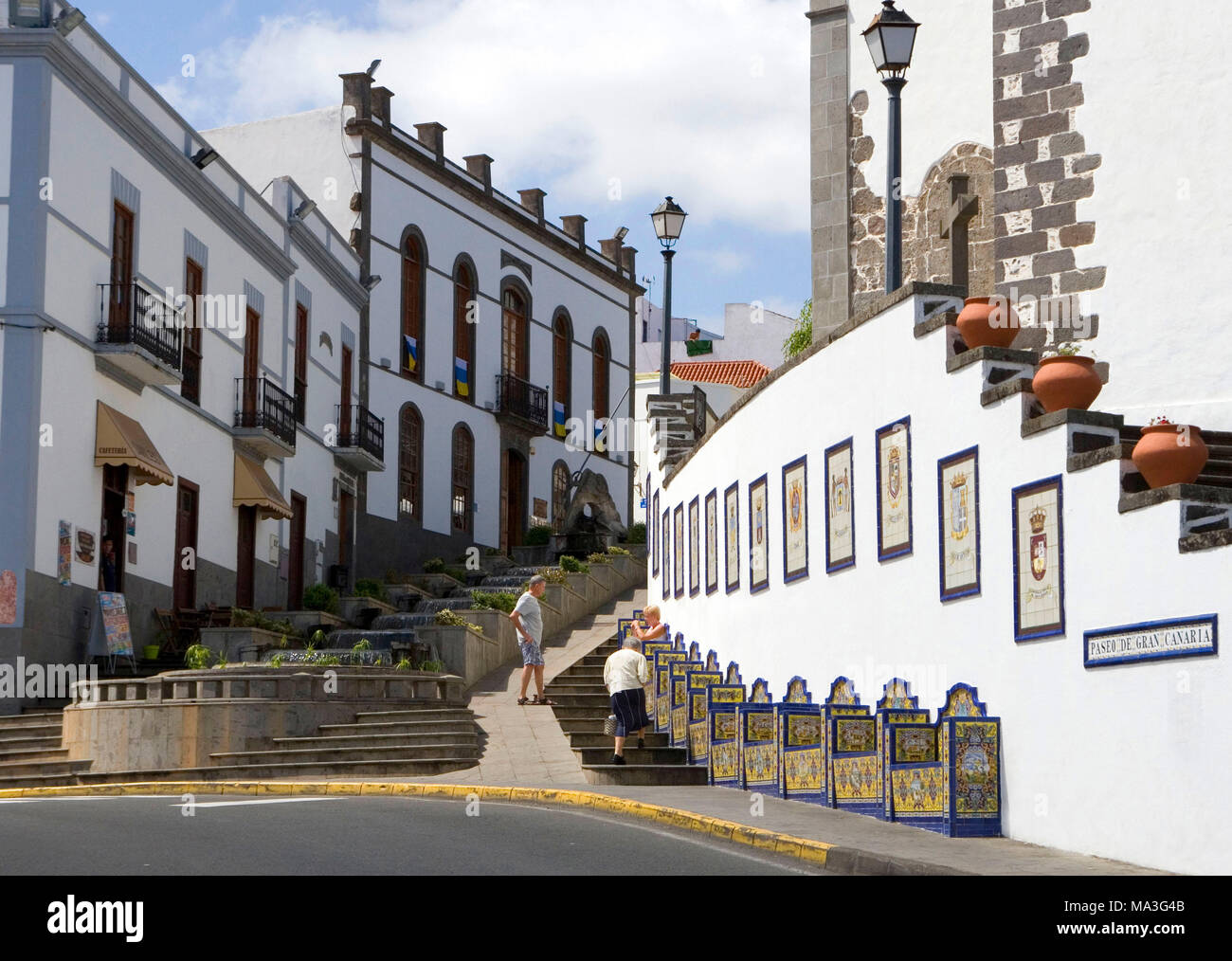 Firgas, Paseo de Gran Canaria,  founded in 1995 by Spanish artists. The lower part shows benches with elaborate tiles which represent 21 parishes of the island. The upper part represents the seven Canary Islands. - Stock Image