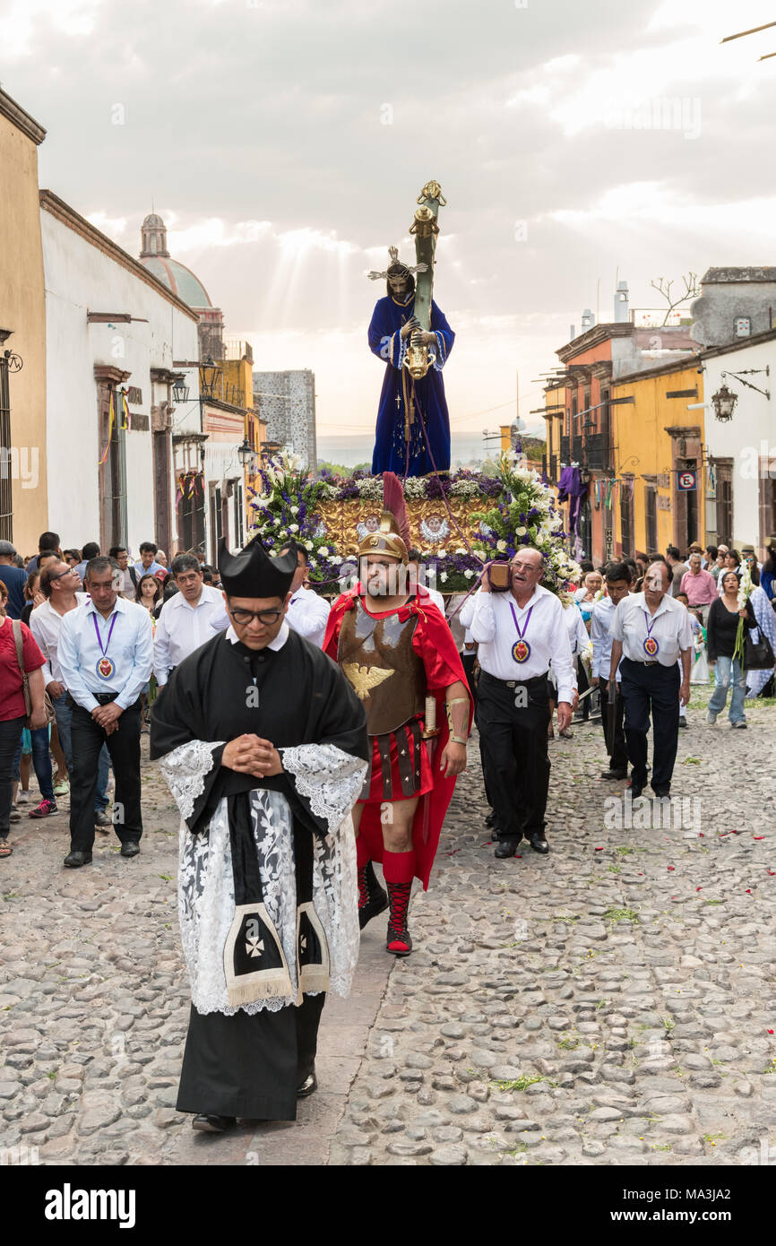 Catholic devotees carry a statue of Jesus during the Las Cruzes del Señor Golpe procession through the streets as part of Holy Week March 28, 2018 in San Miguel de Allende, Mexico. The event is recreation of the passion of Jesus Christ on his way to Calvary for crucifixion. - Stock Image