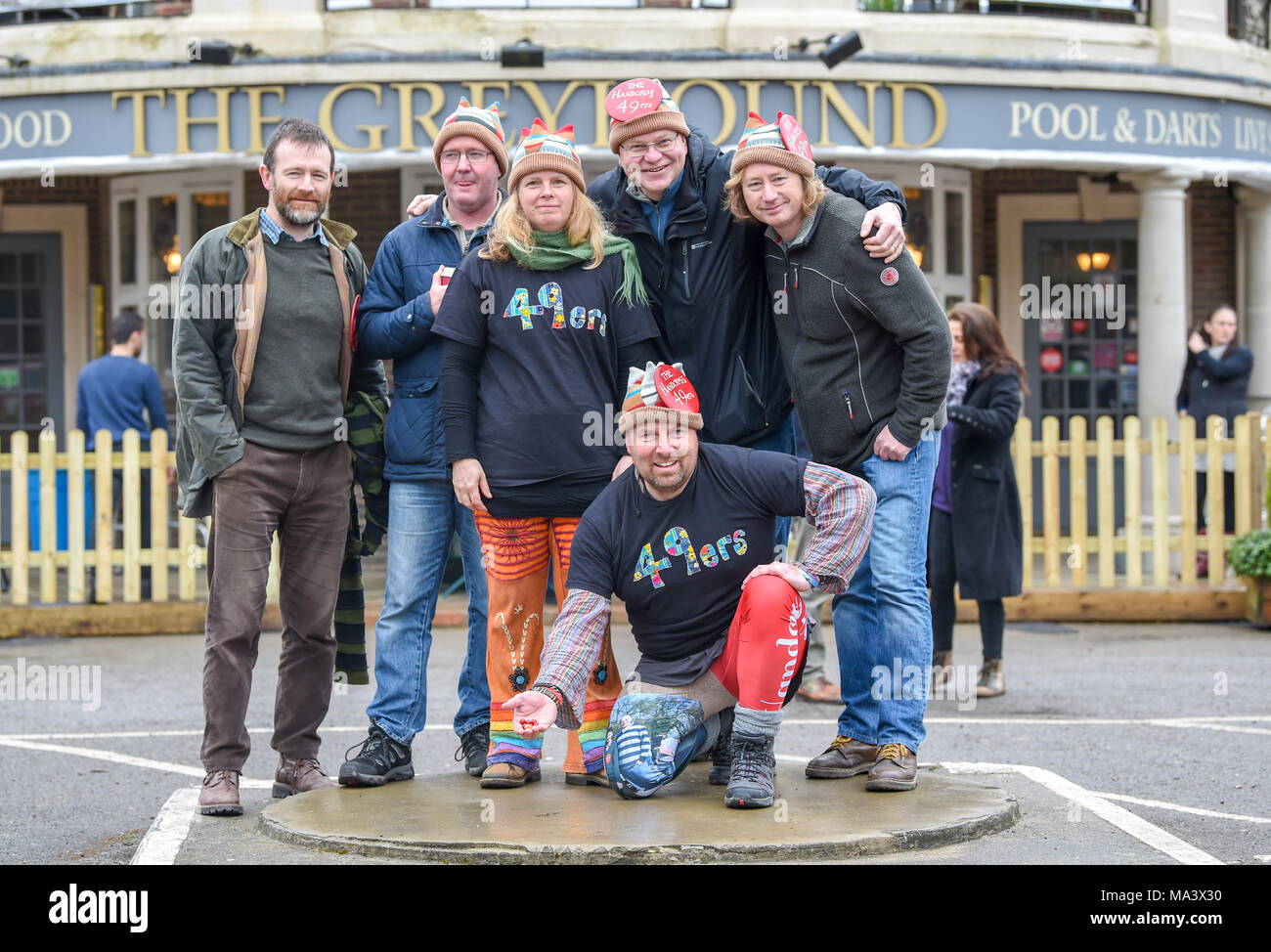 Crawley UK 30th March 2018  - Members of the Handrcoss 49rs team at the World Marbles Championships held at the Greyhound pub in Tinsley Green near Crawley . This event takes place annually every Good Friday and has been played in its current format since 1932 Photograph taken by Simon Dack Credit: Simon Dack/Alamy Live News - Stock Image