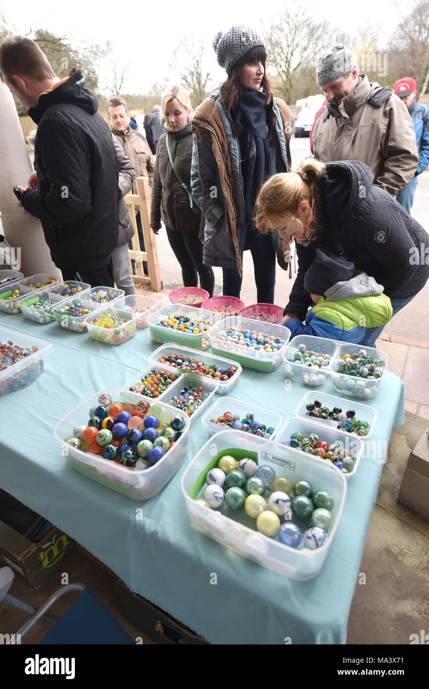 Crawley UK 30th March 2018  - Marbles for sale at the World Marbles Championships held at the Greyhound pub in Tinsley Green near Crawley . This event takes place annually every Good Friday and has been played in its current format since 1932 Photograph taken by Simon Dack Credit: Simon Dack/Alamy Live News - Stock Image