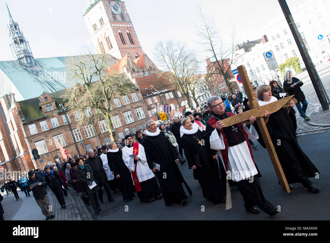 30 March 2018 People Participating In An Ecumenical Good Friday Procession Hold A Wooden Cross The Has Been Lubeck Tradition Since