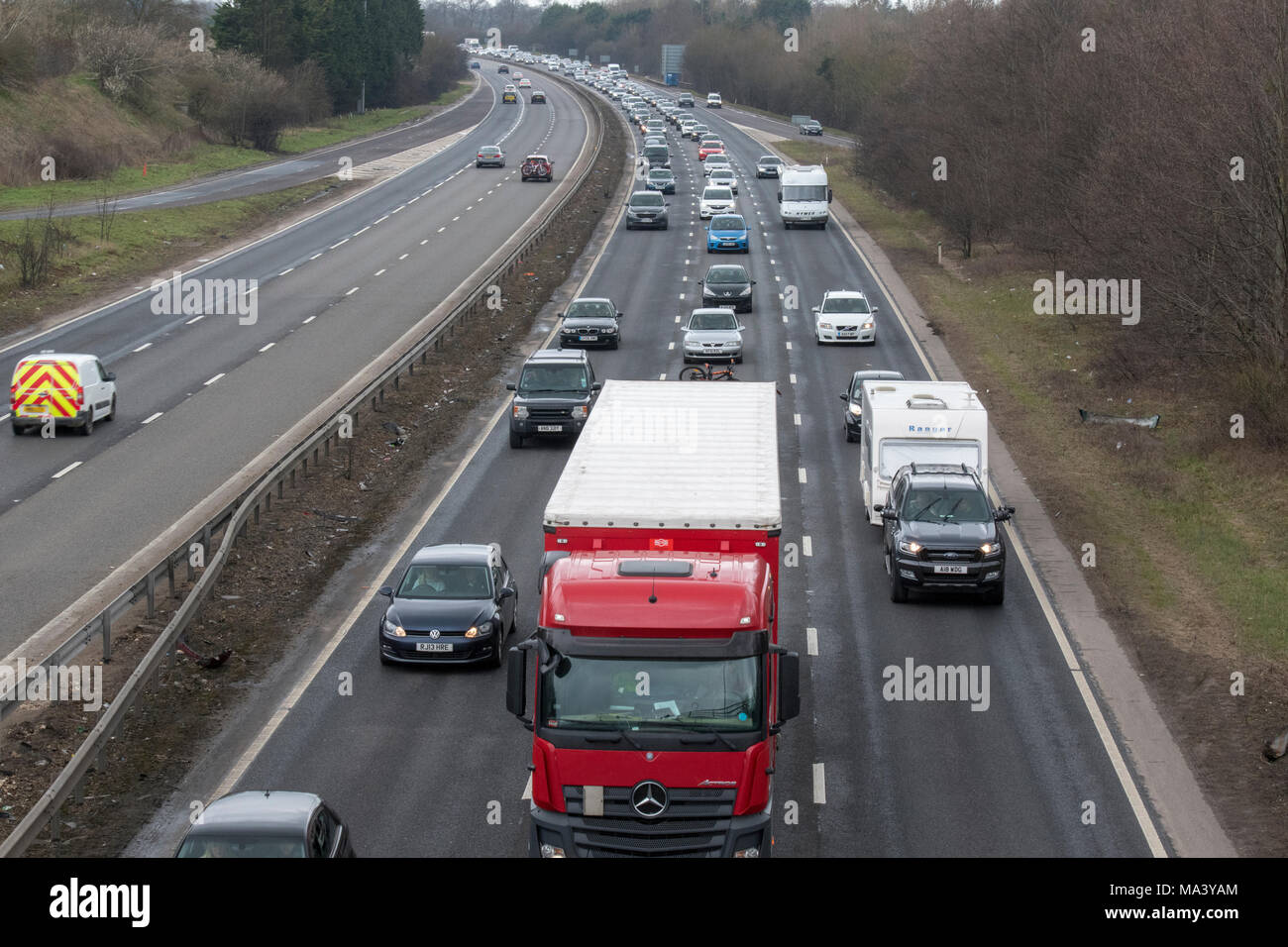 Newmarket, UK. 30th March, 2018. Heavy and slow traffic on the A14 for the start of Easter weekend on Good Friday morning. Newmarket bypass on the A14, eastbound. Credit: Jason Marsh/Alamy Live News - Stock Image