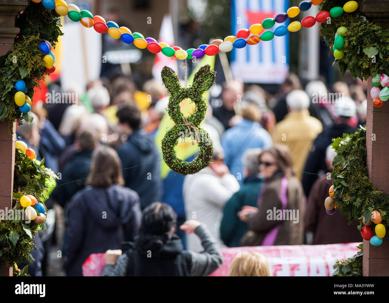 30 March 2018, Germany, Bruchkoebel: Protestors gather for an Easter rally among cheerful decorations. Over Easter, several peace marches are planned in the Hesse region. Topics include demilitarization, German miliary operations in the Middle East, stopping weapons exports and phasing out of nuclear energy. Photo: Frank Rumpenhorst/dpa Stock Photo