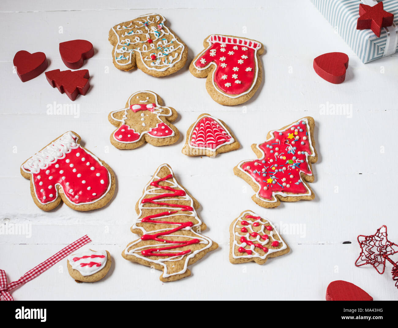 Christmas gingerbread cookies on white wood table Stock Photo ...