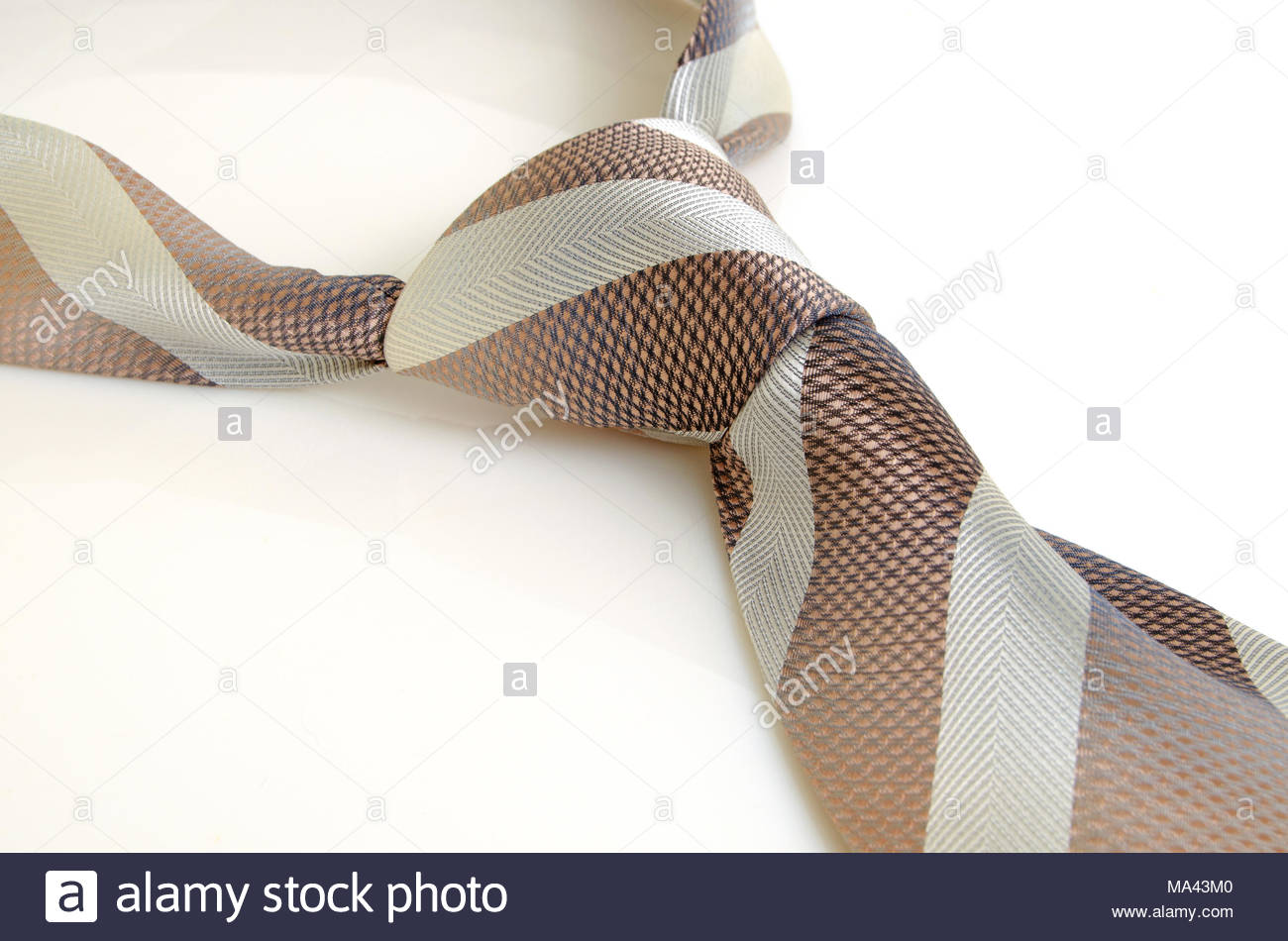 Wide tie with diagonal stripe on a light background. - Stock Image