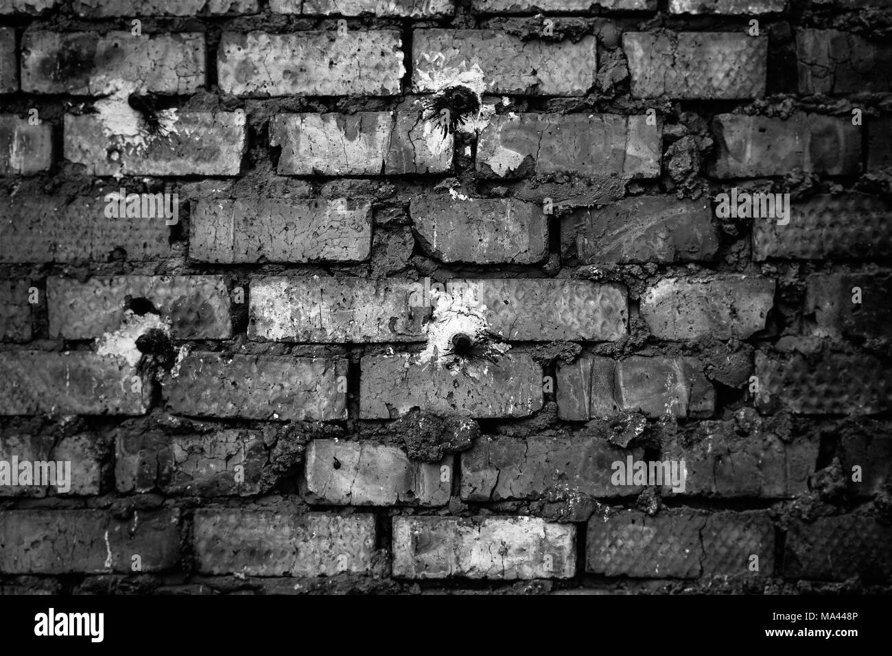 The old red brick wall. Background and texture. Black and white photo - Stock Image