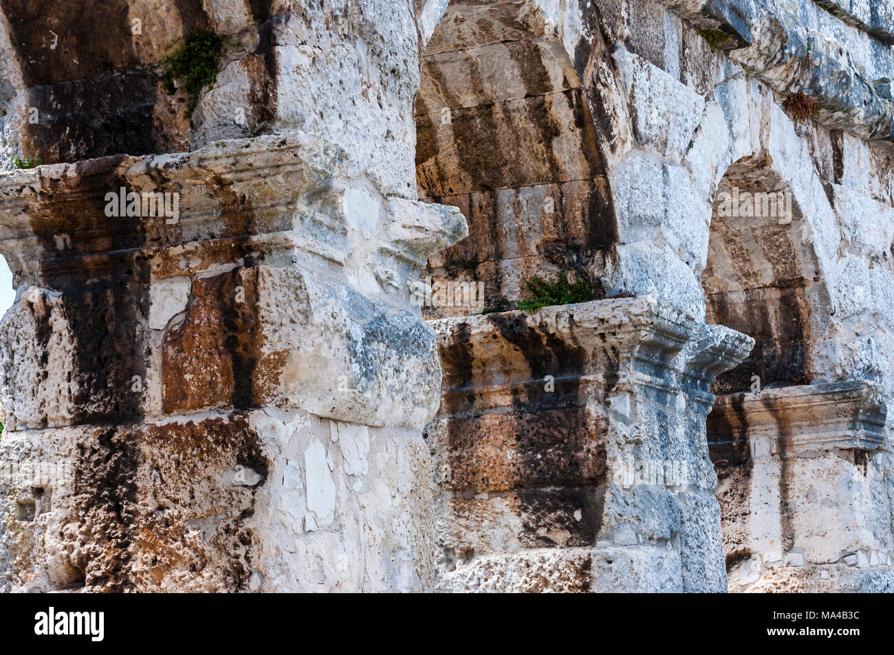 Ancient rows of arc columns in Pula Coliseum monument Stock Photo