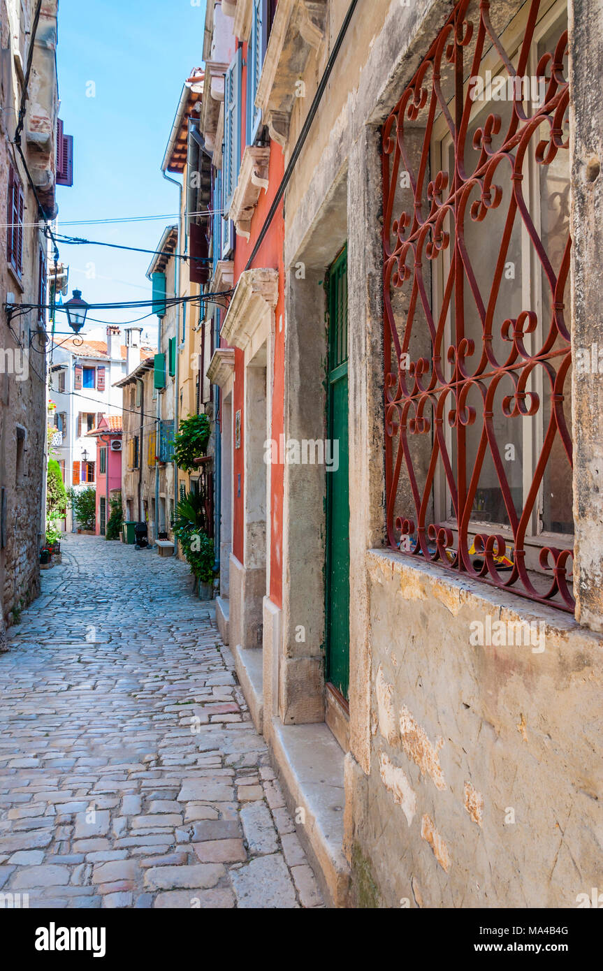 Cozy Old Town paving stone street with medieval buildings facades in Rovinj Istria Croatia Stock Photo