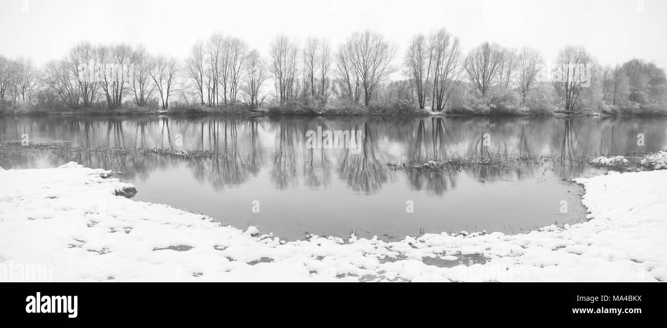 panoramic photo of winter river in the misty morning Stock Photo