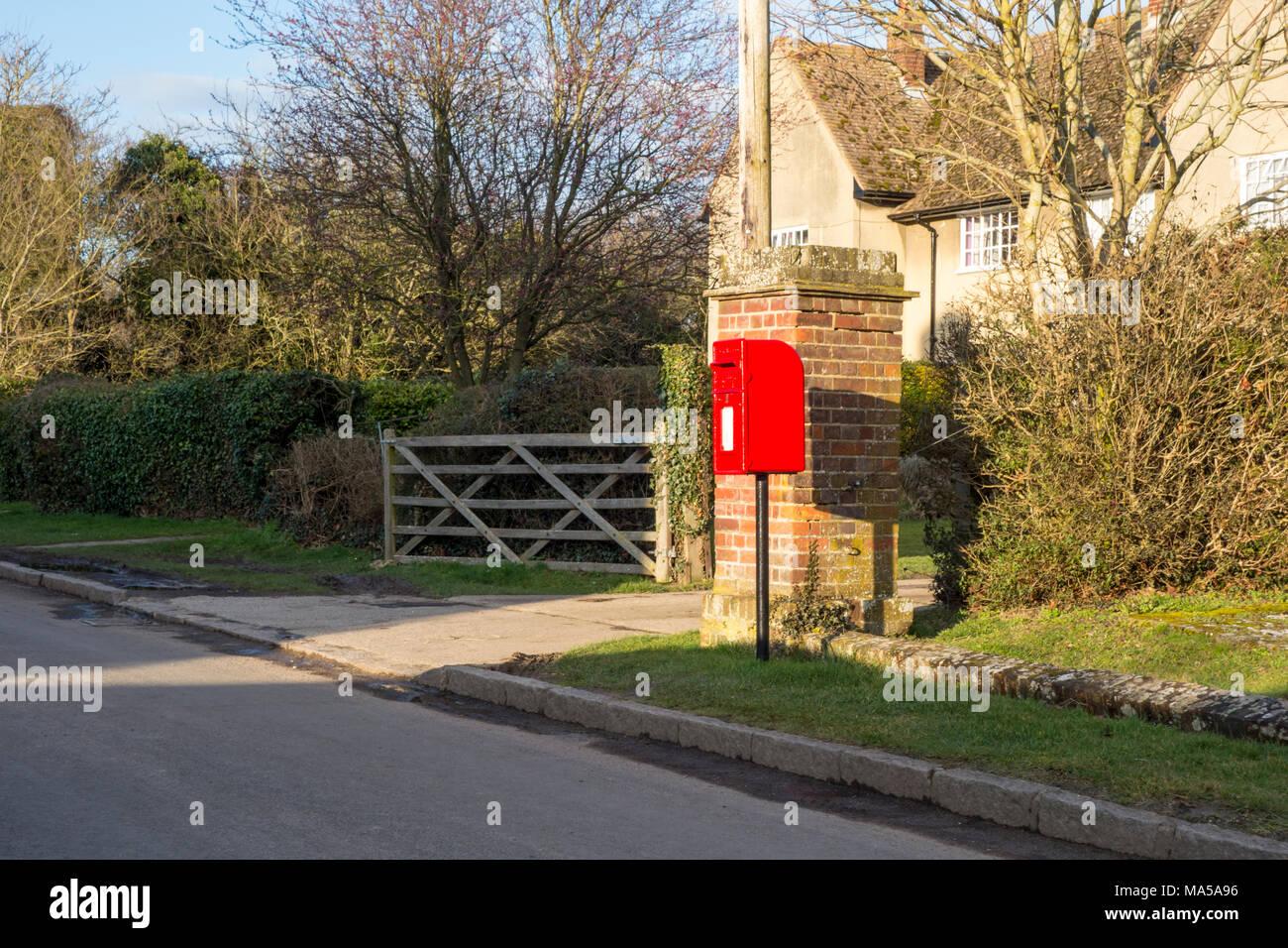 English village red post box, Hexton, Hertfordshire, UK - Stock Image