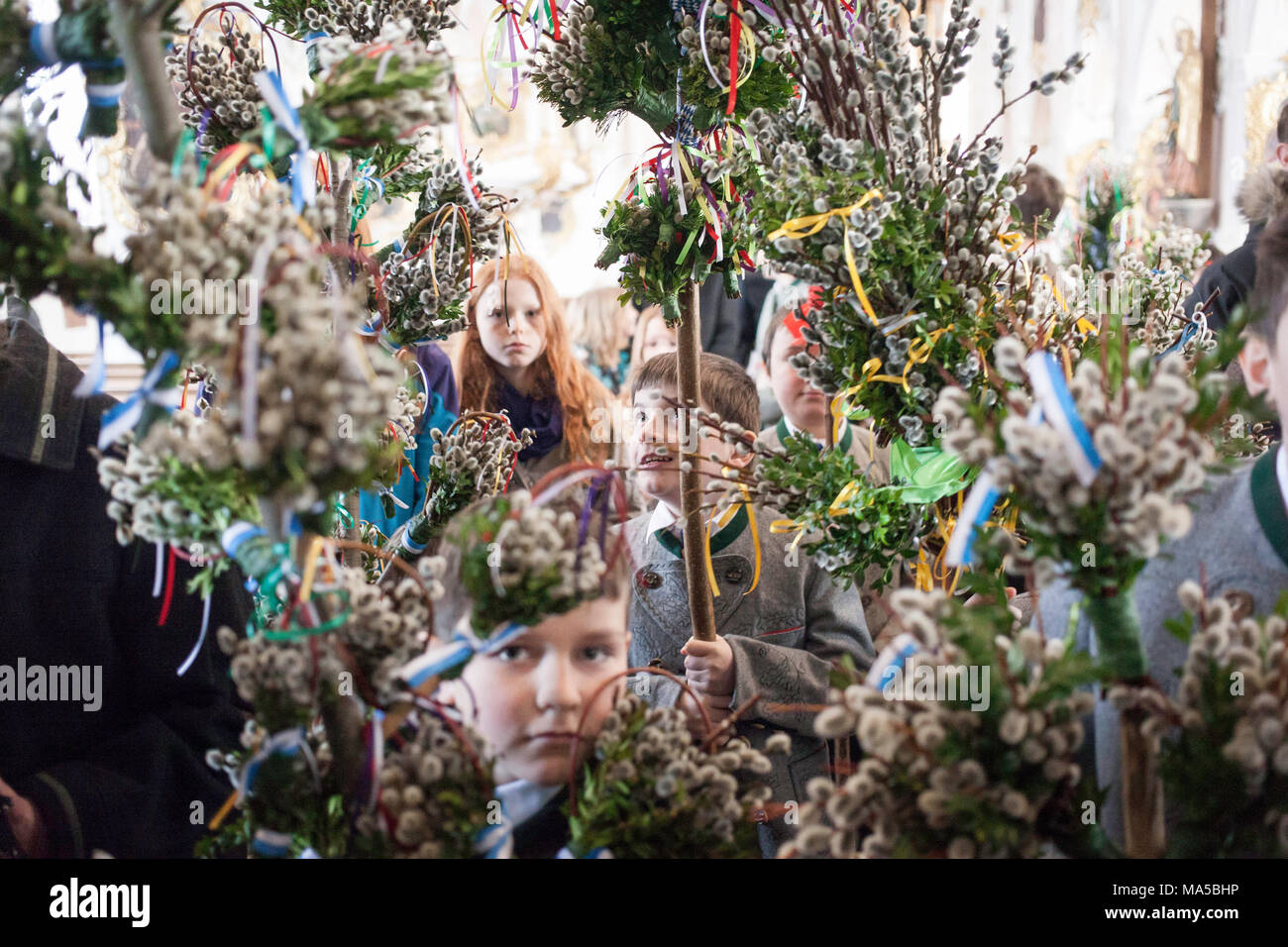 Children with consecrated catkins on Palm Sunday in Martinsmünster in Fischbachau - Stock Image