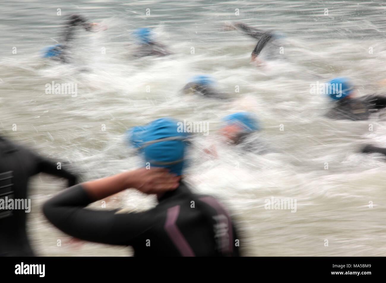Garmin stock photos garmin stock images alamy garmin alps triathlon in schliersee athletes in the water blur stock image buycottarizona Gallery
