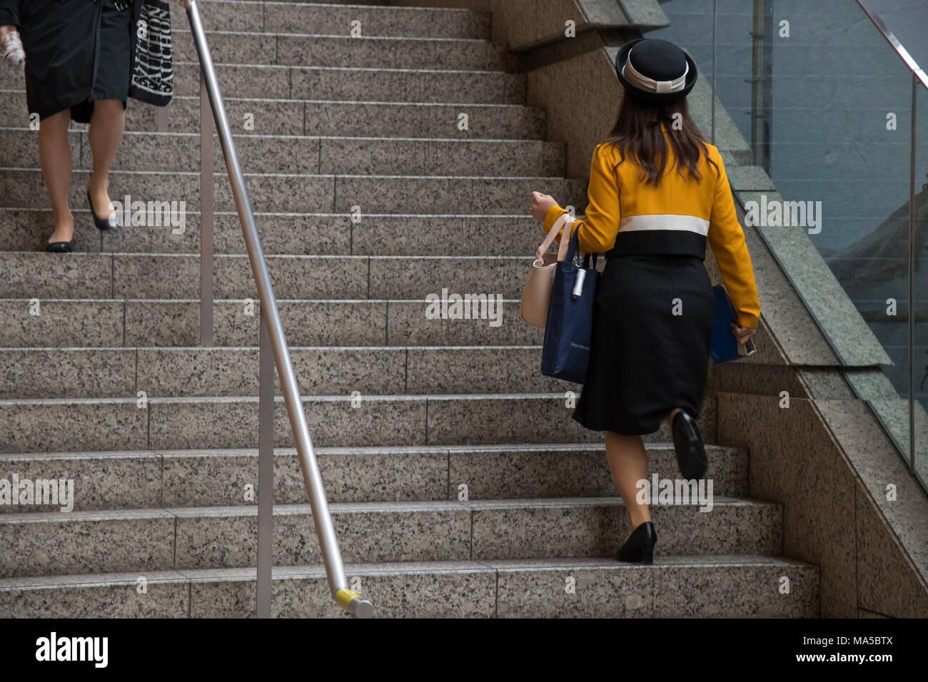Asia, Japan, Nihon, Nippon, Tokyo, Marunouchi, Chiyoda, Tokyo International Forum, woman on stairs - Stock Image