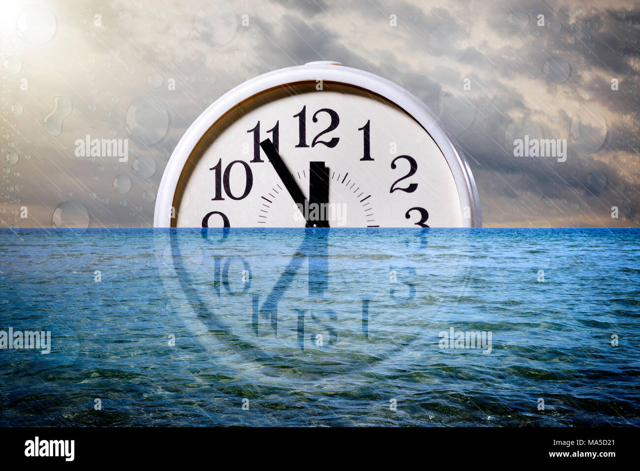 Clock in the water, five to twelve, symbolic picture of climate change - Stock Image