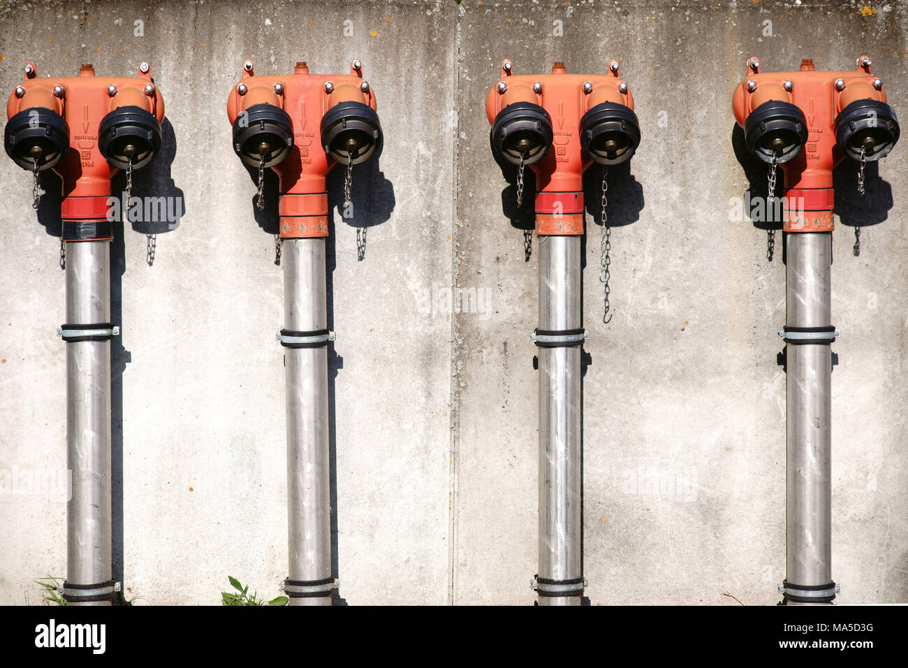 sorted side by side extinguishing water point ona public building, - Stock Image
