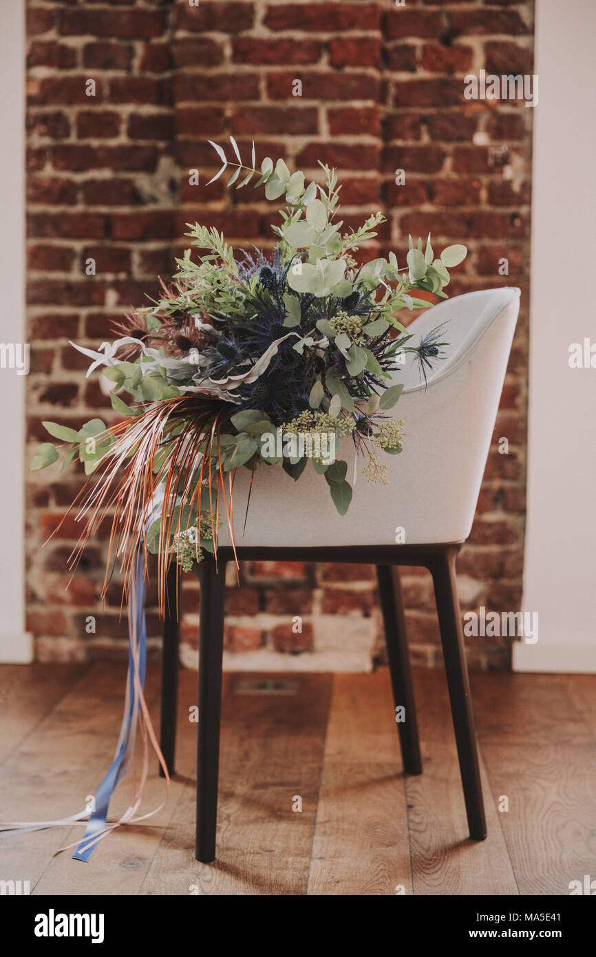 Chair, flower bouquet, - Stock Image