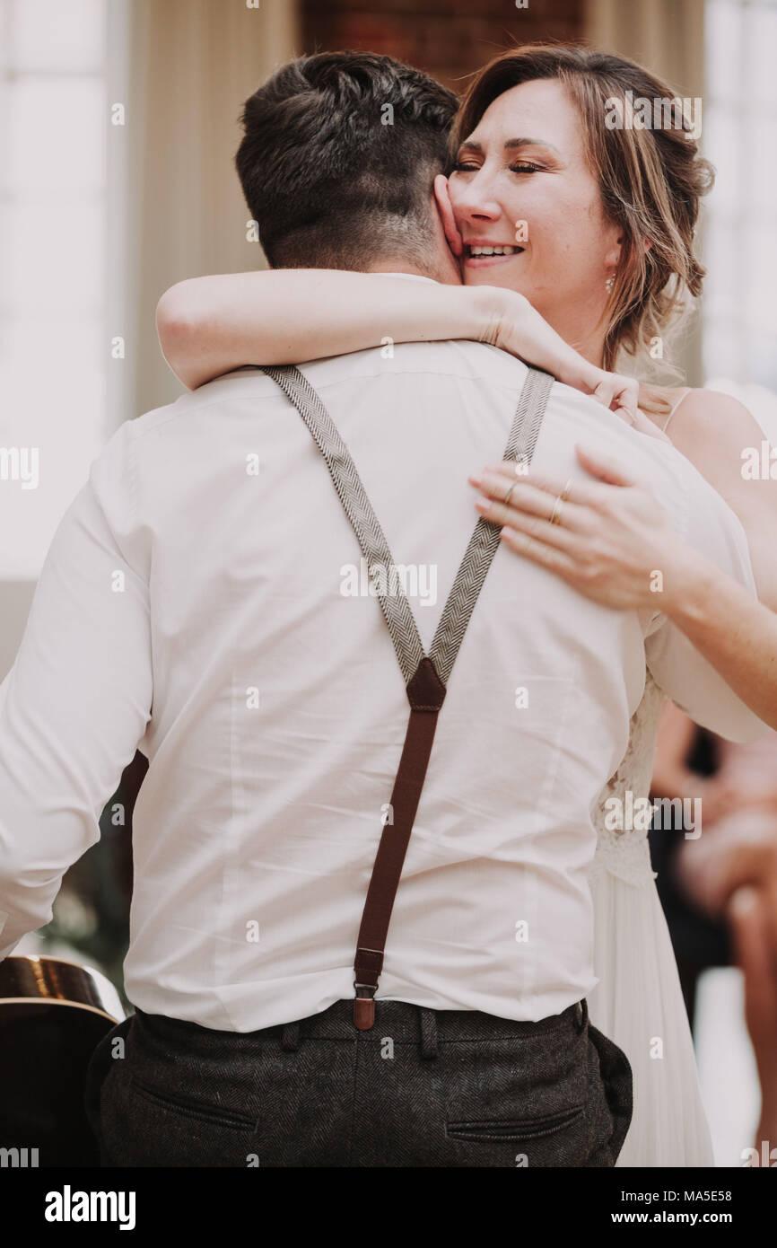 Happy bride hugs a man, congratulations, - Stock Image