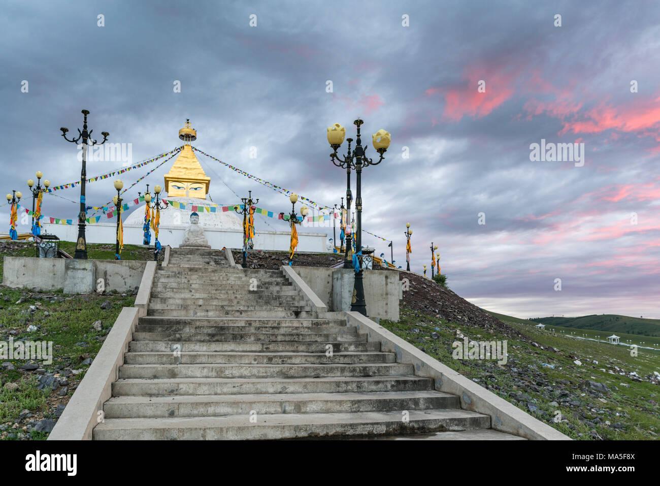 Stairs to the Ovoo above Amarbayasgalant Monastery at sunset. Mount Buren-Khaan, Baruunburen district, Selenge province, Mongolia. Stock Photo