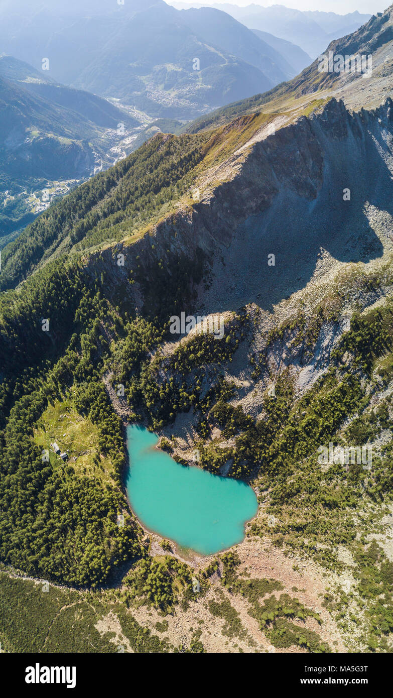 Panoramic of turquoise Lago Lagazzuolo from drone, Chiesa In Valmalenco, Province of Sondrio, Valtellina, Lombardy, Italy - Stock Image