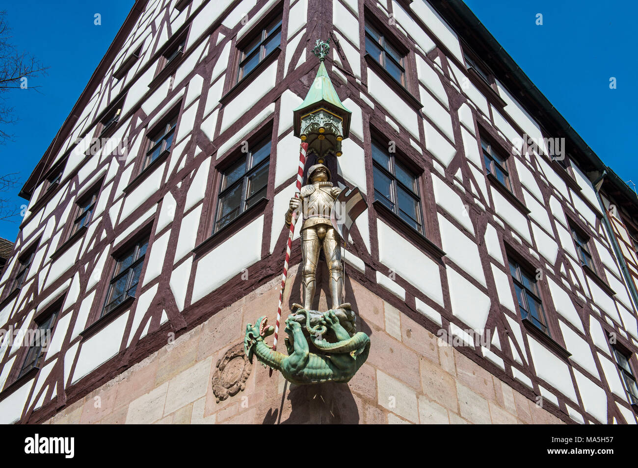 Golden statue on a half timbered house in the medieval town center of Nuremberg, Bavaria, Germany Stock Photo