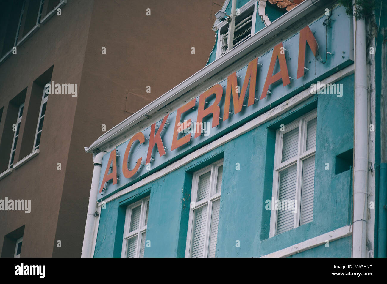 ackerman sign in metal typography in orange color on willemstad, curazao island - Stock Image