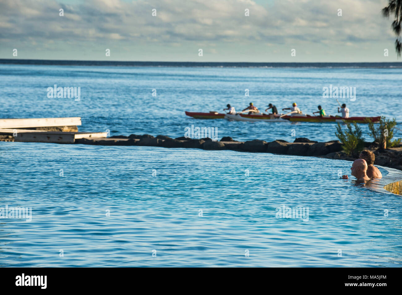 Kayakers working out at sunset, Papeete, Tahiti, French Polynesia - Stock Image