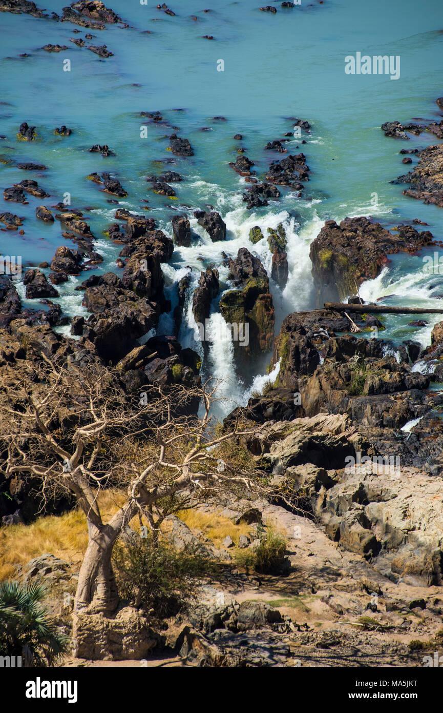 Epupa Falls on the Kunene River on the border between Angola and Namibia, Namibia - Stock Image