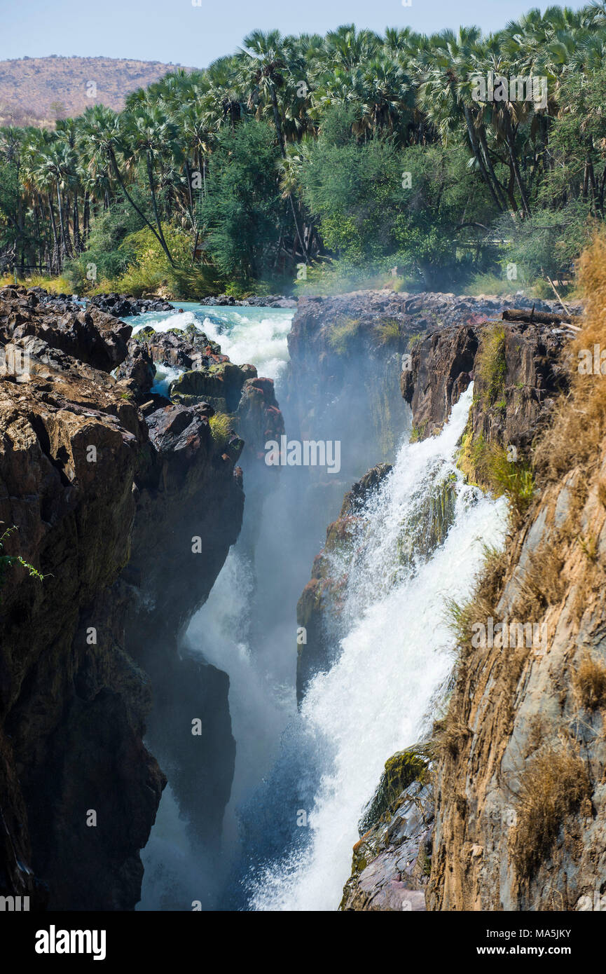 Epupa Falls on the Kunene River on the border between Angola and Namibia, Namibia - Stock Image