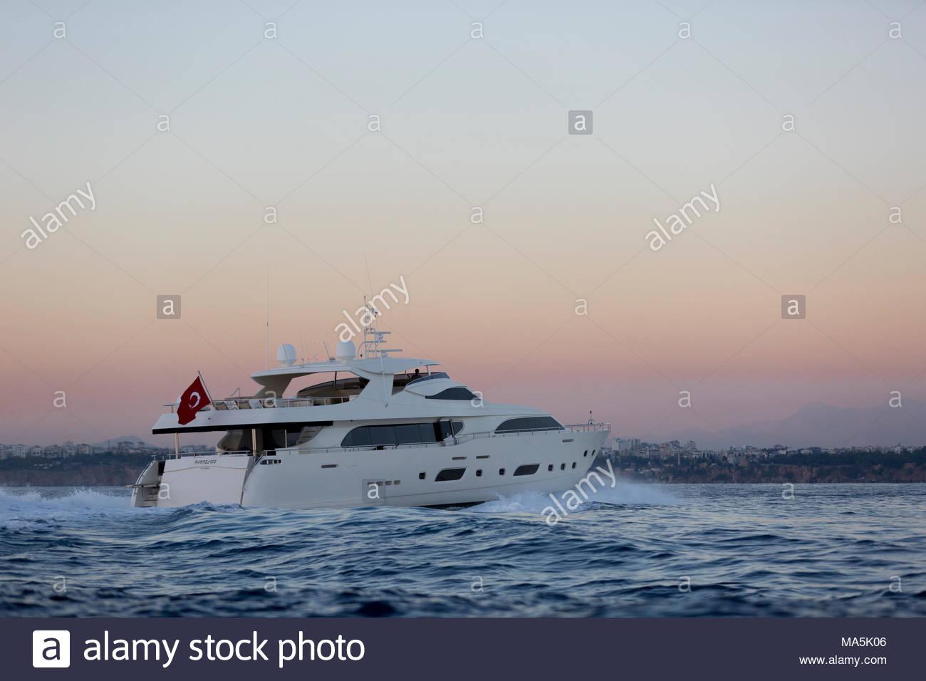 Luxury yacht sailing on the sea sunset - Stock image Yacht, Sunset, Nautical Vessel, Sun, Luxury - Stock Image