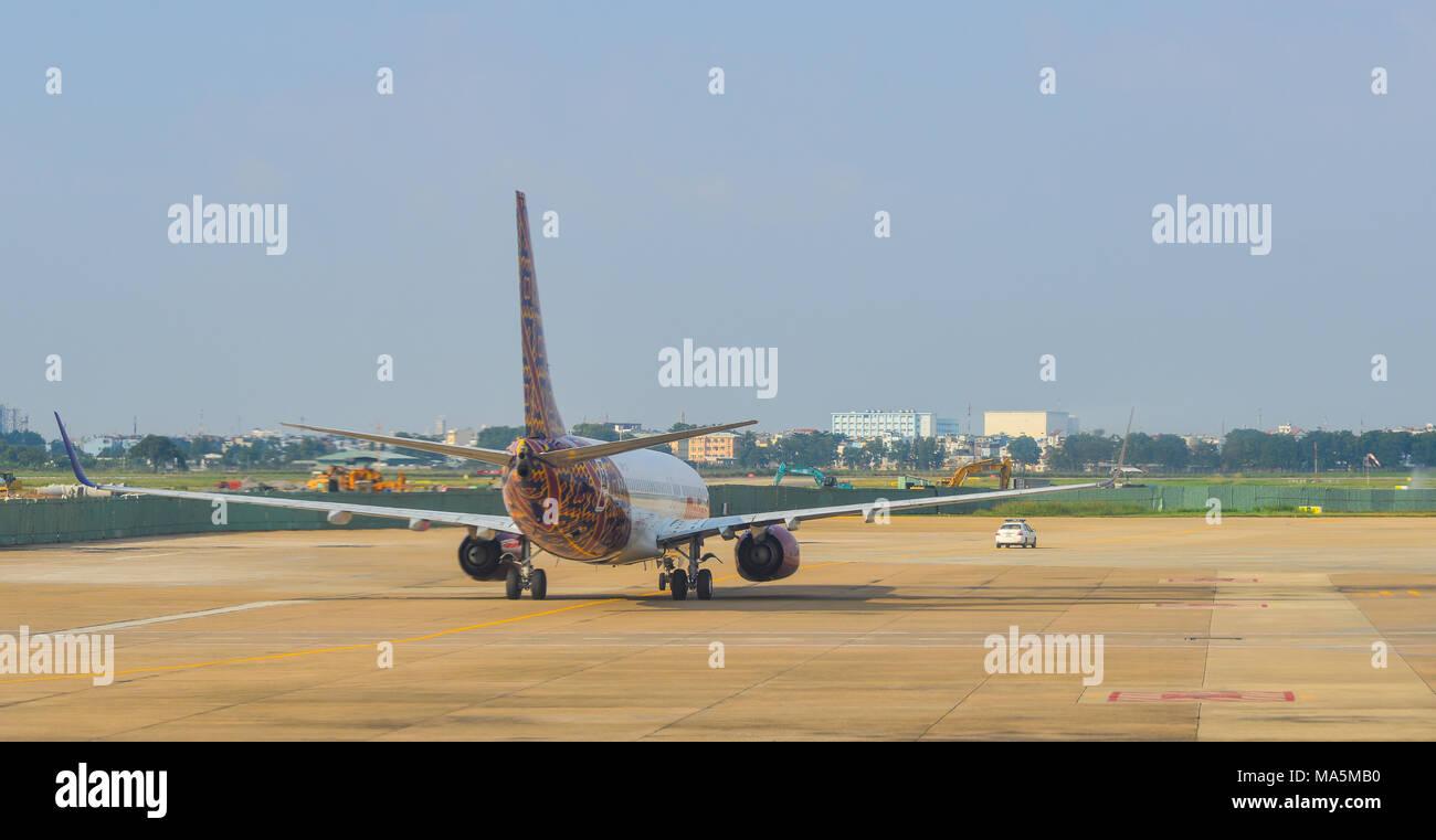 Saigon, Vietnam - Dec 6, 2017. A civil aircraft on runway at Tan Son Nhat Airport (SGN) in Saigon (Ho Chi Minh), Vietnam. Stock Photo