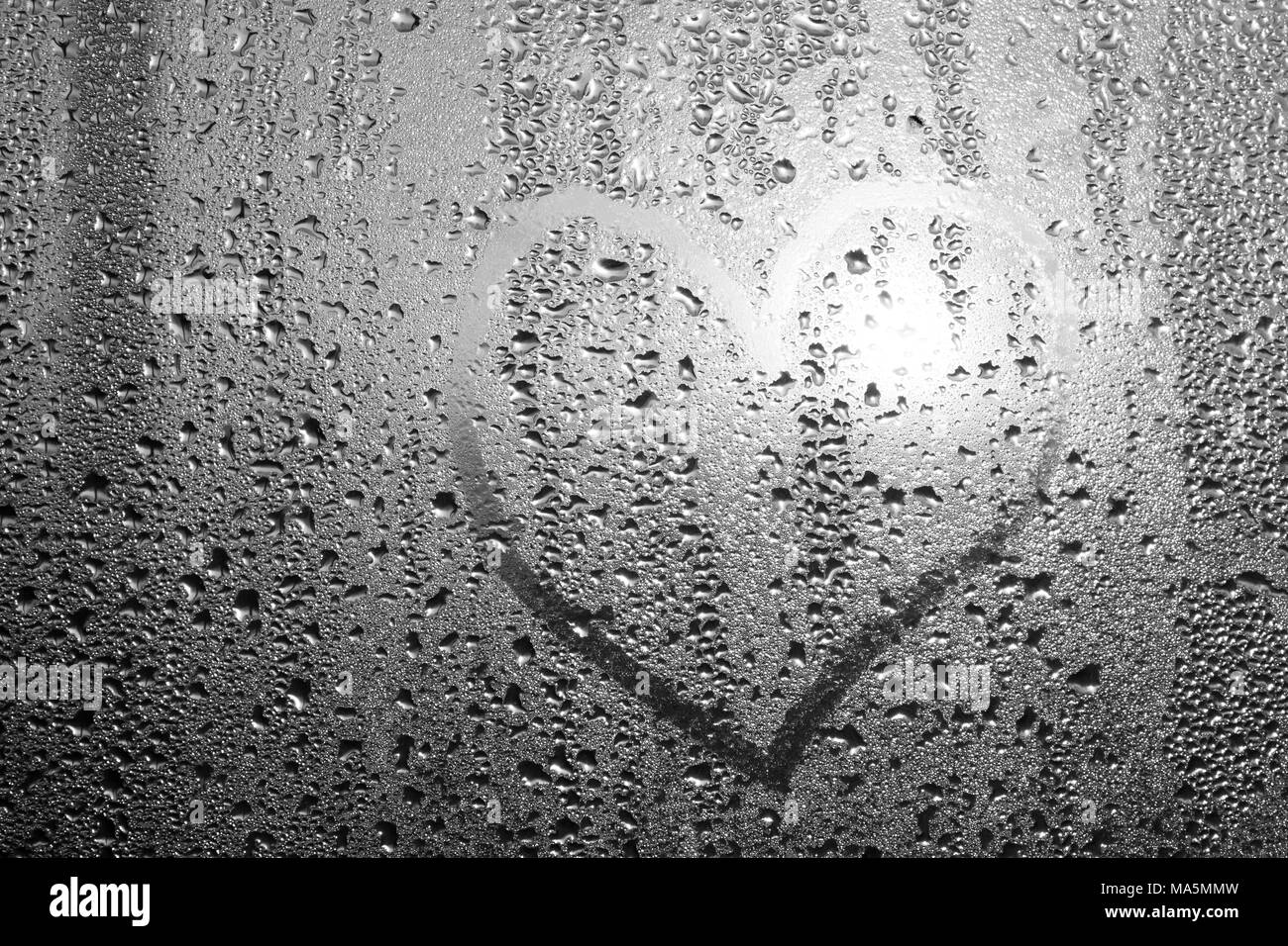 drawing heart on a wet glass. The concept of autumn mood, emotion of love. Copy space for text and notes Stock Photo