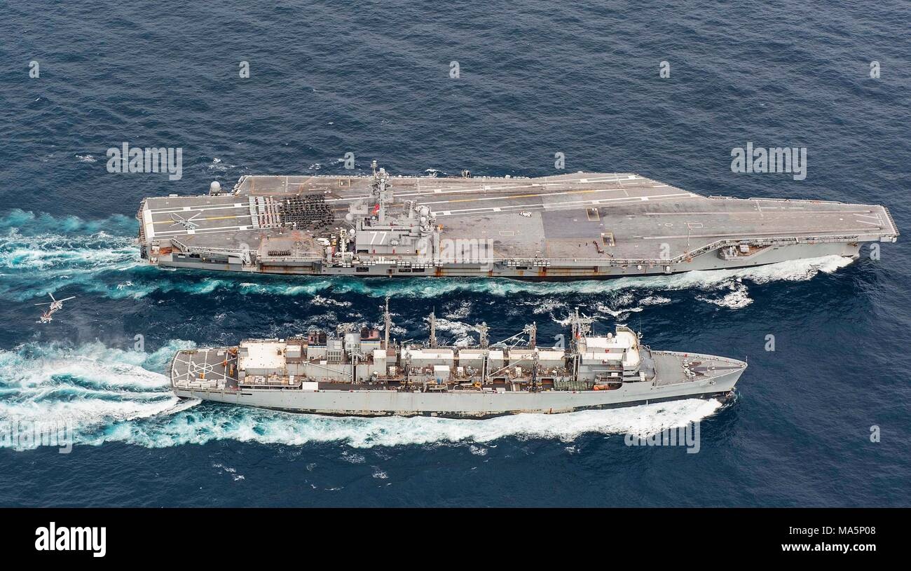 180327-N-JC445-0512 ATLANTIC OCEAN (March 27, 2018) The fast combat support ship USNS Supply (T-AOE 6) sails alongside the aircraft carrier USS George H.W. Bush (CVN 77) during a replenishment-at-sea. The ship is underway conducting sustainment exercises to maintain carrier readiness. (U.S. Navy photo by Mass Communication Specialist 3rd Class Mario Coto) - Stock Image