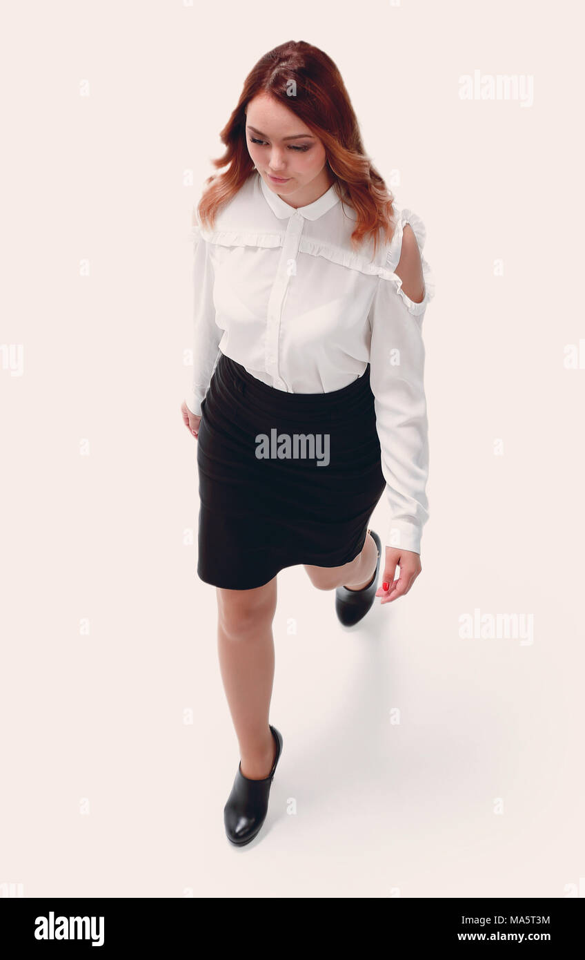 5773d426e4 Attractive young woman wears white blouse, black skirt Stock Photo ...