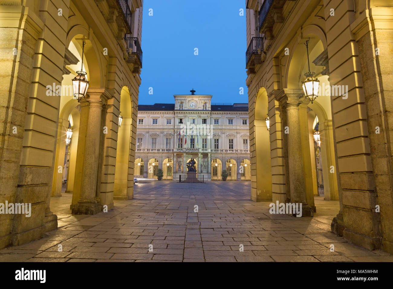 Turin - The square Piazza di Citta with the Palazzo Civico and Monumento al Conte Verde at dusk. - Stock Image