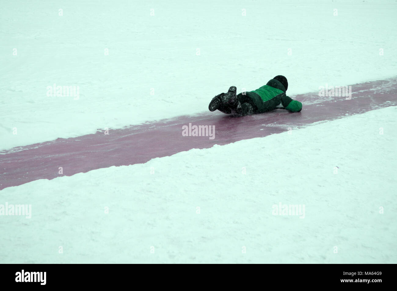 Slip on the slippery ice and snow on the road track at the country in freezing winter day - Stock Image