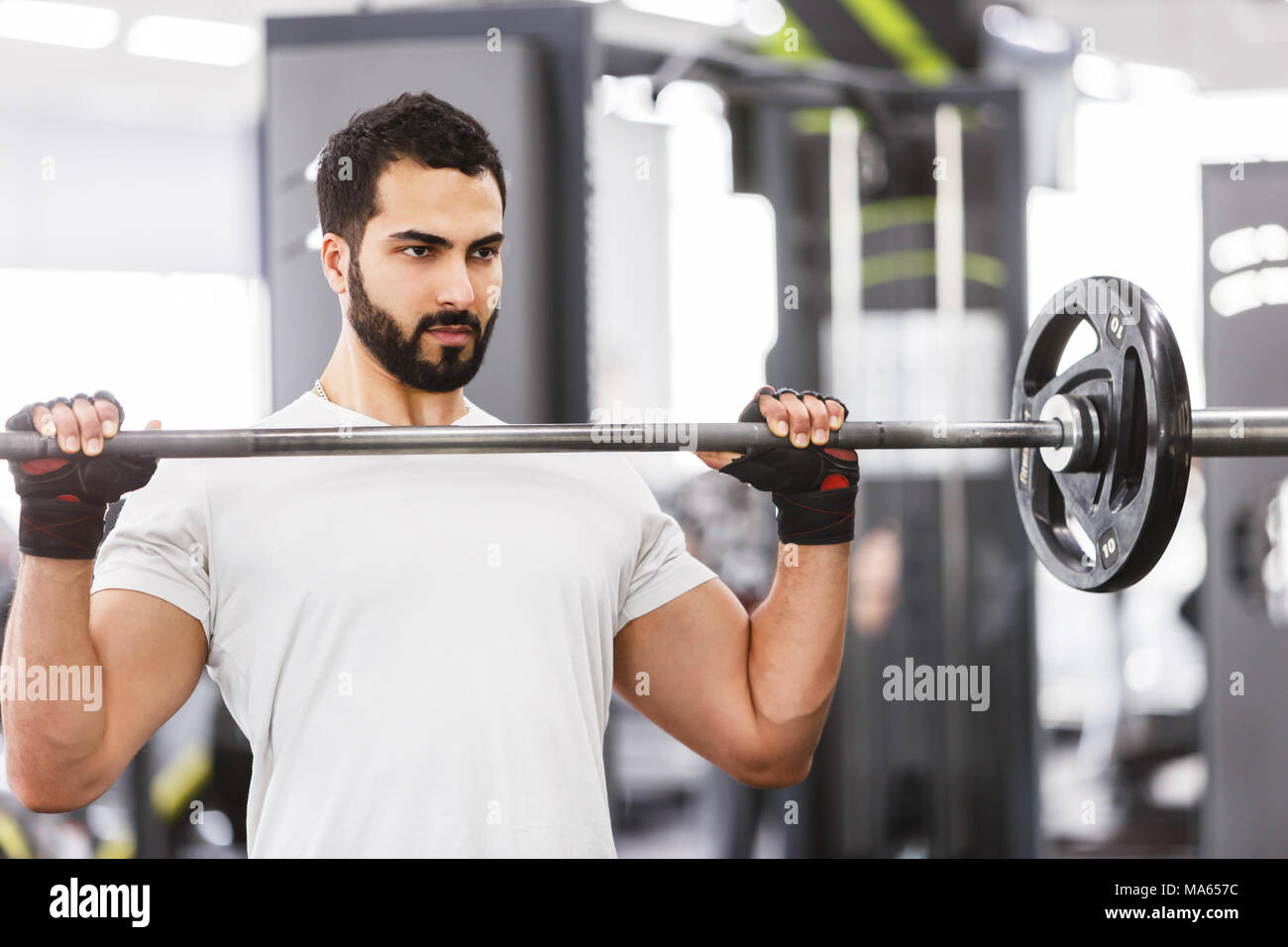 Man with Barbell - Stock Image